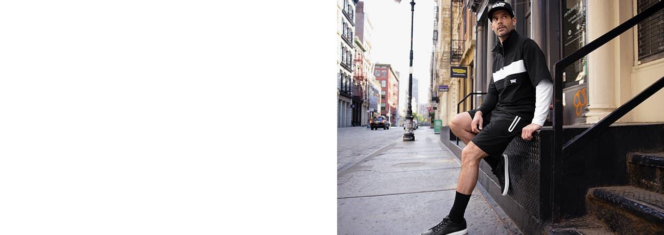 Man Wearing PXG Apparel Long Sleeve Block Polo, Anorak Jacket & Comfort Stretch Shorts   PXG