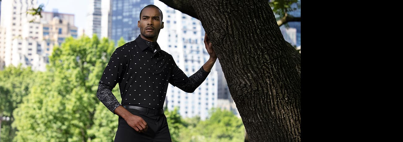 Man in City Wearing PXG Succulent Print Polo, Fairway Camo Baselayer & Infinite Belt   PXG