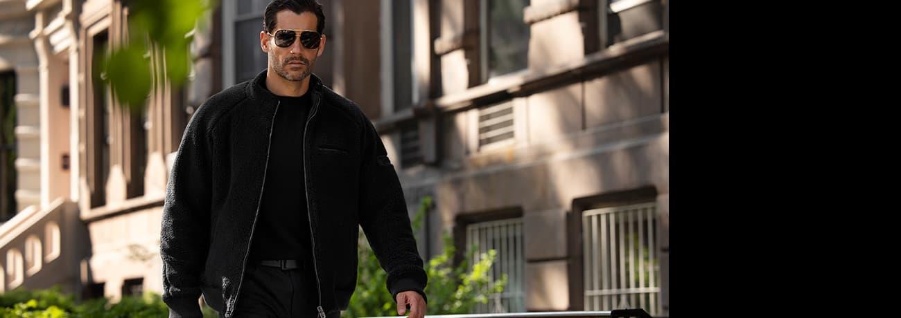 Man Walking Down Block in PXG Apparel Cashmere Sweater, Full Zip Raglan Jacket, & Infinite Belt   PXG