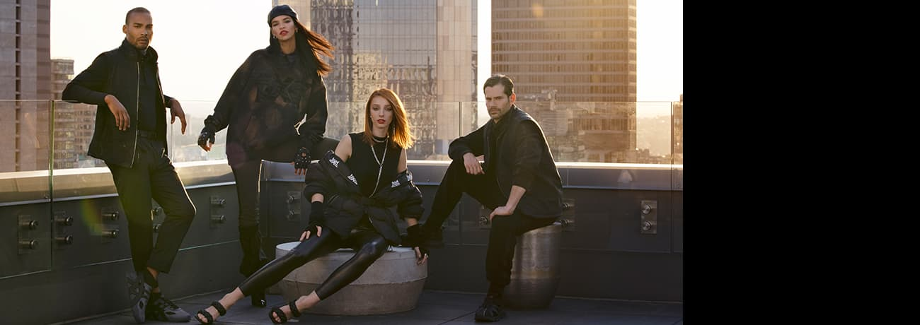 Men and Women Wearing Fall Winter 2021 PXG Apparel on City Rooftop   PXG