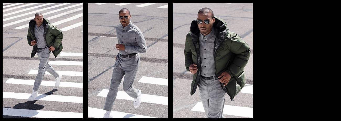Man Crossing Street in PXG Apparel Plaid Snap Shirt, Infinite Belt and Warrior Green Puffer Jacket   PXG