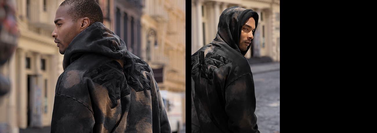 Man Walking Down Street in PXG Faiwary Camo Logo Hoodie   PXG