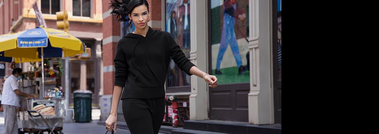 Woman Walking Down Street in PXG Apparel Off Duty Hoodie & Joggers   PXG