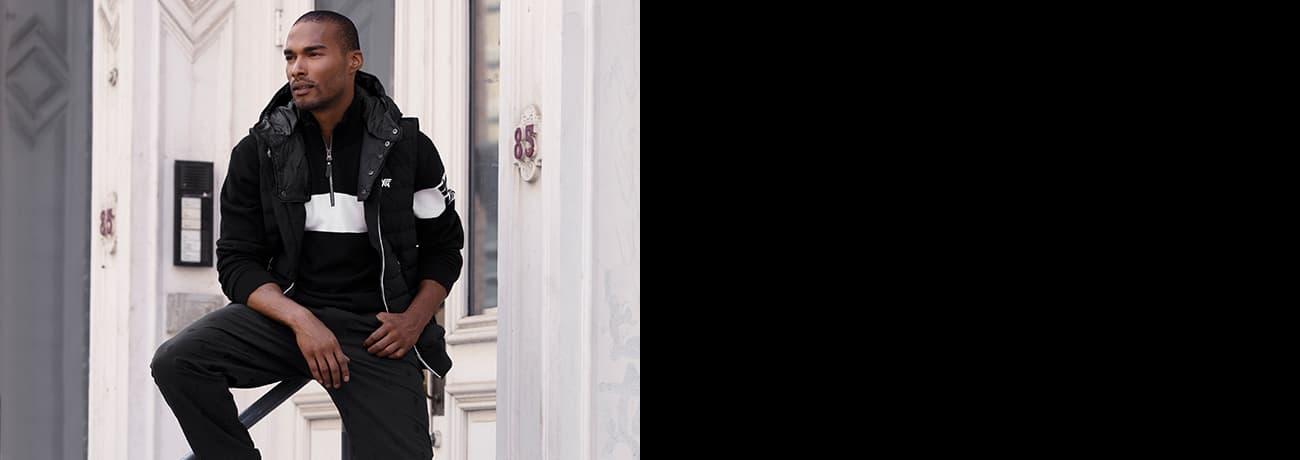 Man Sitting Wearing White Strip Quarter Zip Sweater   PXG
