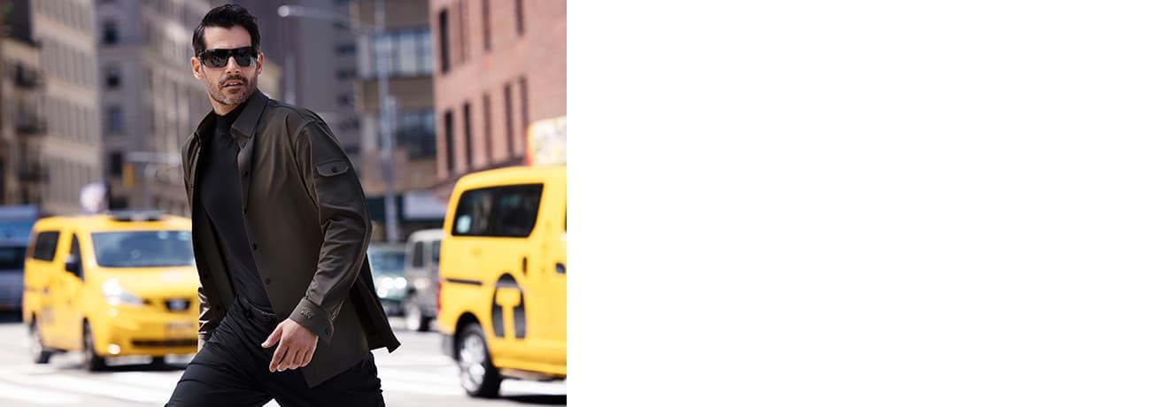 Man Crossing Street in PXG Apparel Two-Tone Long Sleeve Mock Neck, Golfing Pants & Infinite Belt | PXG