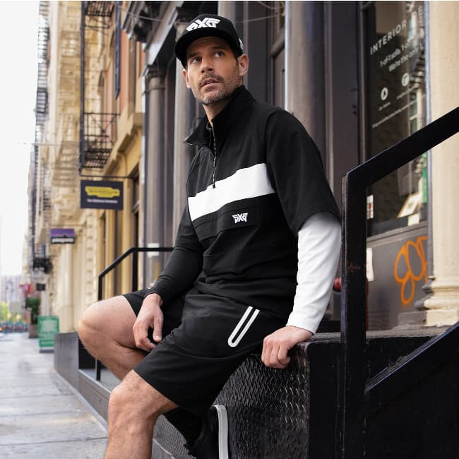 Men's Apparel Long Sleeve Block Sleeve Polo, Short Sleeve Anorak Jacket, Comfort Stretch Shorts and Performance 9FIFTY Stretch Fit Cap | PXG