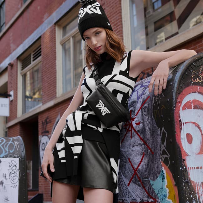 Womens Apparel All Over Bold Logo Sweater Vest, Sweater, Eco-Leather Skirt, Classic Leather Crossbody Fanny Pack, Big Head Cuff Beanie with Pom | PXG