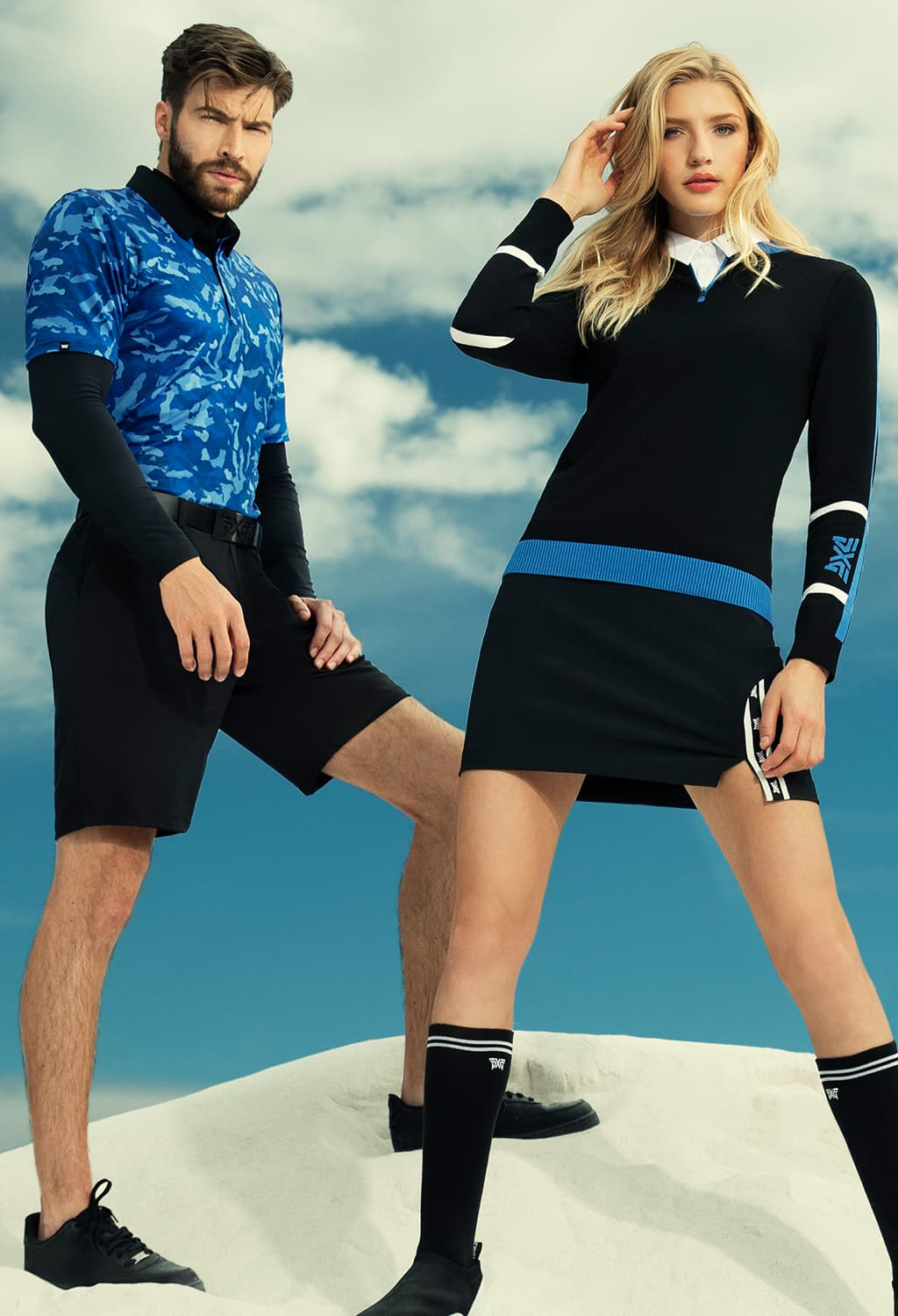 Man and woman modeling PXG apparel