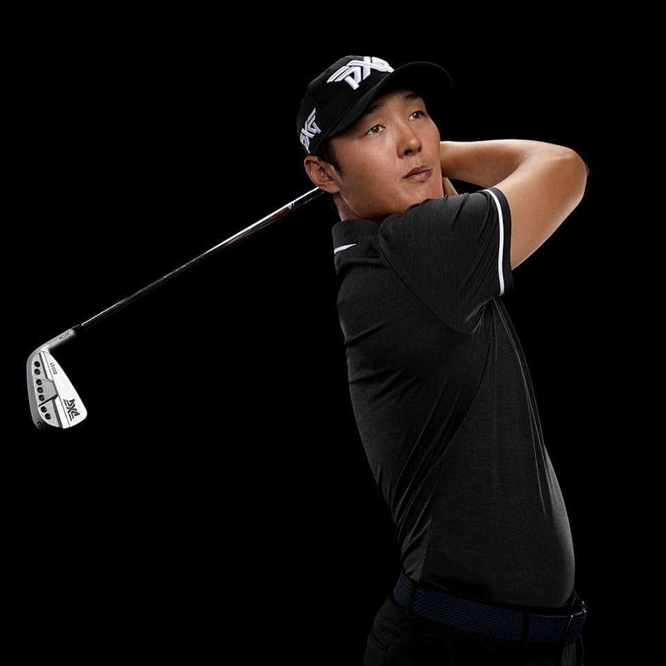PXG TOUR Pro Danny Lee swinging a golf club in a studio.