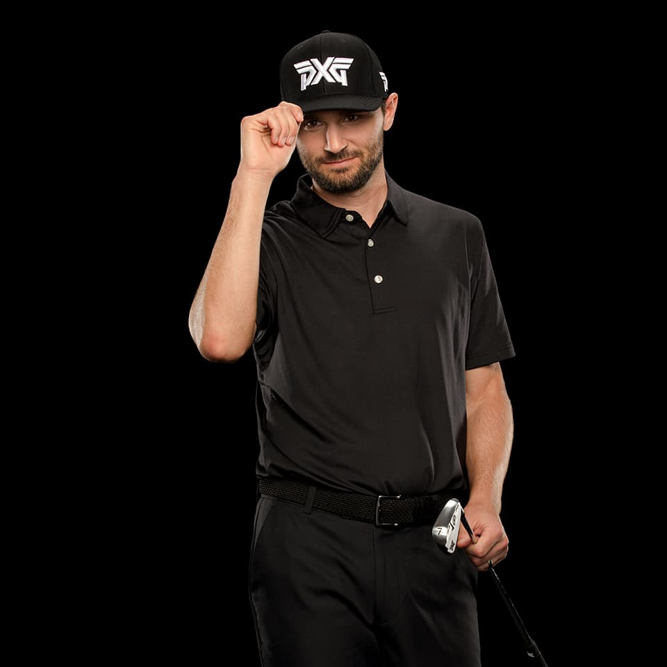 PXG TOUR Pro Kyle Stanley tipping his golf hat a studio.