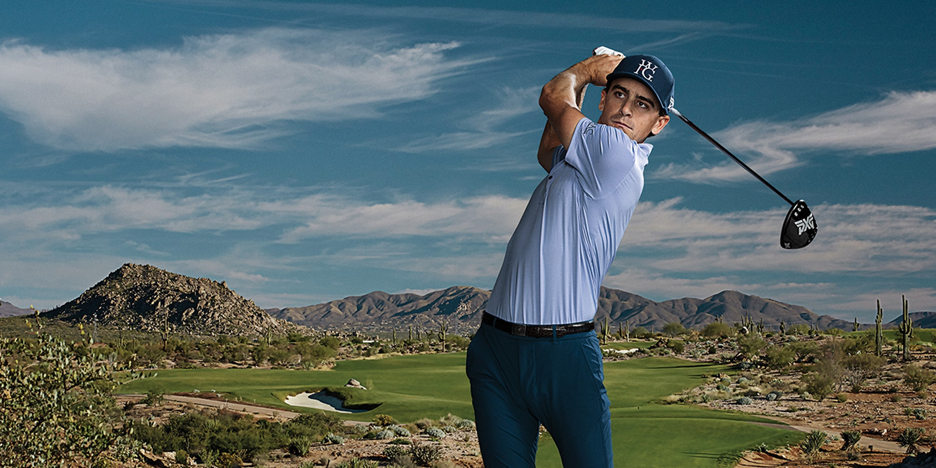 Left handed PGA TOUR Pro Scott Langley teeing off with a GEN2 PXG Driver