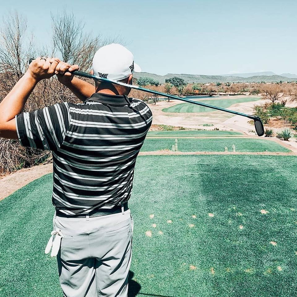 Roy Urbac playing golf