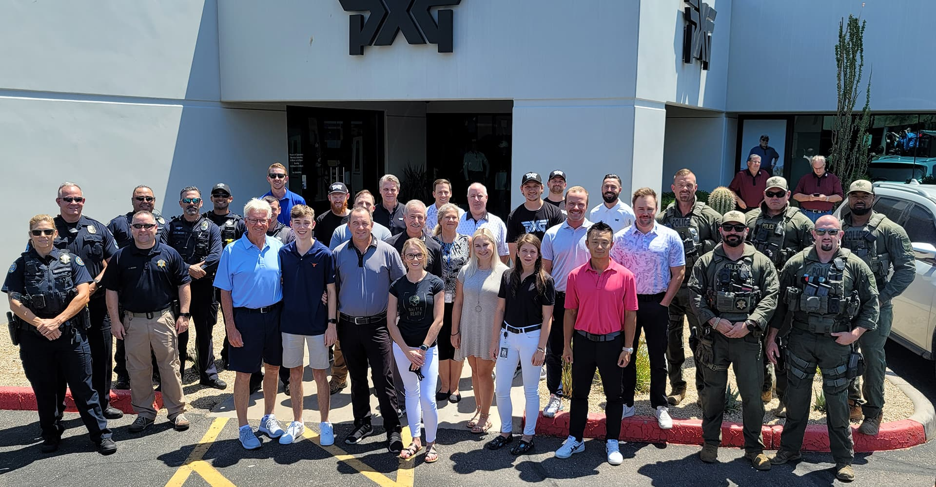 Make a Wish Kid Sam Gullion, First Responsders, Military personel and PXG employees outside PXG headquarters