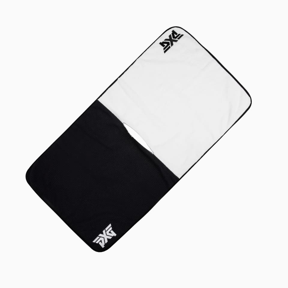 A half and half black and white pxg golf towel