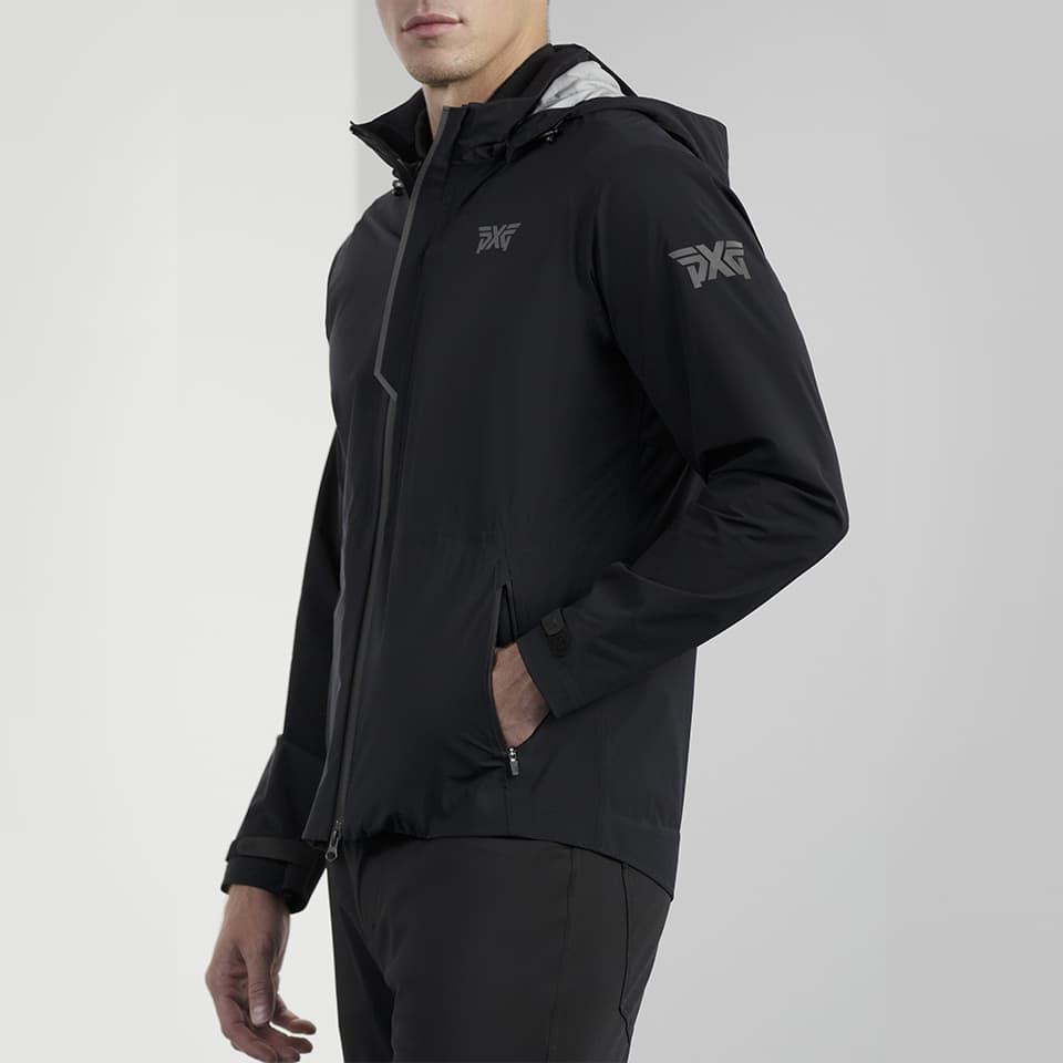 Model wearing a PXG Men's Black Complete Hooded Rain Jacket