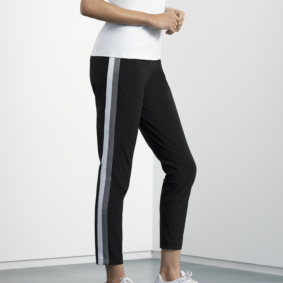 Model wearing a pair of PXG stripe pants in black with a white stripe