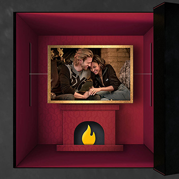 Day 14: Couple in front of fire place
